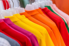 Asian men cloth fashion colorful market industry. Concept. shirt hanging sale in the supermarket Stock Image