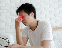 Asian men are not comfortable with pain stock photos