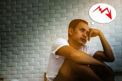 Asian men are not comfortable with pain stock photo