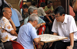 Asian men playing GO Stock Photo