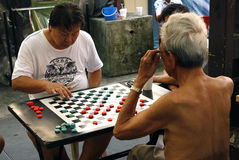 Asian men playing Go Stock Images
