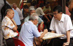 Asian men playing Go Stock Photography