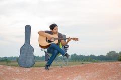 Asian men playing guitar Stock Images