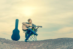 Asian men playing guitar Royalty Free Stock Photography