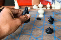 Asian men playing Thai chess. Royalty Free Stock Photography