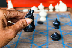 Asian men playing Thai chess. Royalty Free Stock Images