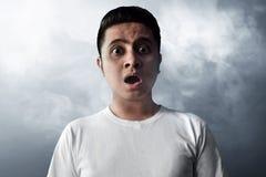 Asian men surprised on smoke background. Asian man surprised on smoke background Stock Photo