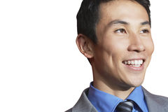 Asian mid-adult businessman smiling against white background Stock Photo