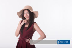 Asian middle age woman in red dress with search engine graphic. S Royalty Free Stock Image