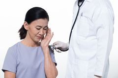 Asian Middle 60s age Woman Patient check up health royalty free stock image