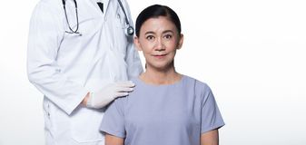 Asian Middle 60s age Woman Patient check up health. With Doctor. Aging Society lady concern on healthcare diagnose with medical expertise, studio lighting copy stock image