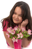 Asian miling girl with pink flowers Royalty Free Stock Photo