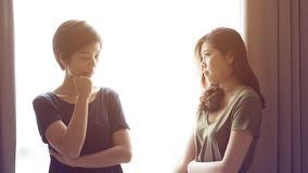 Asian mixed race woman friends listen to problems stock photography