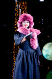 Asian model. ULAN-UDE, RUSSIA - OCTOBER 29: A model wears a winter coat and a fur hat in ethnic style at the international asian fashion festival on October, 29 Stock Images