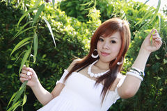 Asian model. Pose with green leaf at garden Royalty Free Stock Photos
