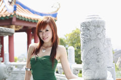 Asian   model. Pose  infront a  beautiful  fence Stock Photo