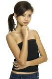 Asian Model 8. A pretty young asian woman in a black top and denim skirt Royalty Free Stock Photography