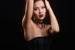 Asian model in black dress and eye, design necklace long hair Stock Image