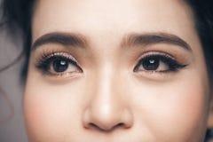 Asian model eye close-up with long eyelashes. Selective focus Royalty Free Stock Image