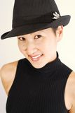 Asian Model in Fedora. Beautiful Asian model in black fedora Royalty Free Stock Photo