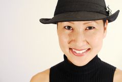 Asian Model in Fedora. Beautiful Asian model in black fedora Royalty Free Stock Images