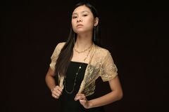Asian model  formal dress dark brown background Stock Photography