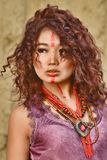 Asian model with make-up on face in feulette dress against haystack background Stock Images