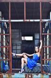 Asian Model in metal construction Royalty Free Stock Photos