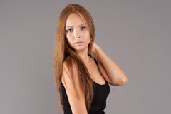 Asian model portrait. On gray background Royalty Free Stock Image