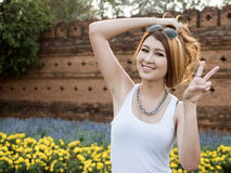 Asian Model Posing in Natural Setting Royalty Free Stock Images