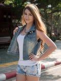 Asian Model Posing in Natural Setting. Beautiful Blonde Thai Asian Model Poses in Outdoor Natural Setting stock image