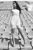 Asian model posing at the stadium sitting on bright seats Stock Photography