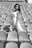 Asian model posing at the stadium sitting on bright seats Stock Image