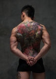 Asian model with tattoo. Fit male model with oriental tattoo Royalty Free Stock Photos