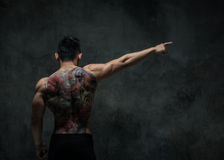 Asian model with tattoo. Fit male model with oriental tattoo Stock Photos
