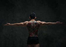 Asian model with tattoo. Fit male model with oriental tattoo Royalty Free Stock Photography