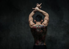 Asian model with tattoo. Fit male model with oriental tattoo stock photo