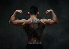 Asian model with tattoo. Fit male model with oriental tattoo stock photography
