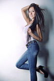 Asian model in white T-shirt and jeanse,long hair  and legs Royalty Free Stock Photography