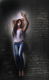 Asian model in white T-shirt and jeanse,long hair  and legs Stock Image