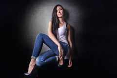 Asian model in white T-shirt and jeanse,long hair  and legs Royalty Free Stock Photo