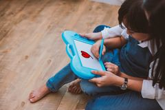 Asian mom teaching cute boy to drawing red heart in board with color pen. Back to school and Education concept. Family and Home. Sweet home theme. Preschool royalty free stock photography