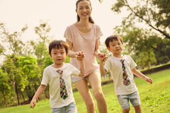 Asian mom wwith twins boys Stock Photography