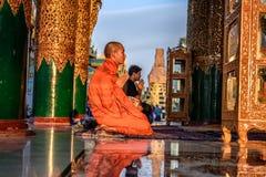 Asian monk prays  in the Shwedagon Pagoda Temple Royalty Free Stock Photo