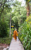 A asian monk walks on the walkway Royalty Free Stock Images