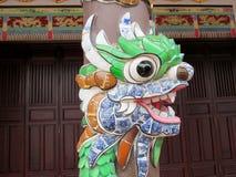 Asian mosaic dragon head. Asian mosaic dragon on a column of the temple Stock Photo