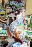 Asian mosaic ornament with dragon on the temple column Stock Photo