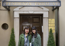 Asian Mother and Amerasian teenage daughter in front of the Residenza Paolo VI stock images