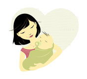 Asian mother and baby. Asian mother holding baby in front of a heart Stock Photos
