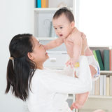 Asian mother and baby at home. Stock Photos